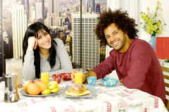 Happy couple having breakfast in front of skyscrapers in city looking camera Royalty Free Stock Photography