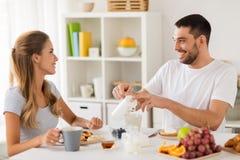 Happy couple having breakfast at home Stock Photography