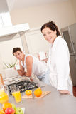 Happy couple having breakfast in the kitchen Royalty Free Stock Images