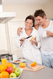 Happy couple having breakfast in the kitchen Stock Photo