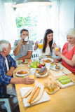 Happy couple having breakfast with their parents stock photos