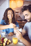 Happy couple having breakfast together Stock Images