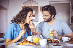 Happy couple having breakfast together Royalty Free Stock Photos