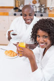 Happy couple having breakfast together at table Stock Image