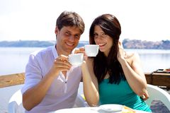 Happy couple having breakfast in vacation in Italy Stock Images