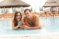 Happy couple having cocktails Royalty Free Stock Images