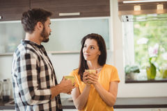 Happy couple having coffee in kitchen Royalty Free Stock Image