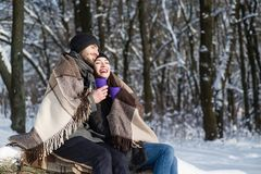 Happy couple having cuddles in the winter outdoors stock images