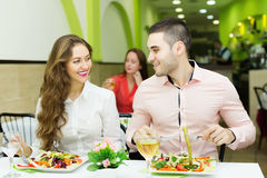 Happy couple having a dinner at the restaurant Royalty Free Stock Image