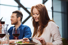 Happy couple having dinner at restaurant Royalty Free Stock Image