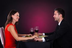 Happy couple having dinner Stock Photos