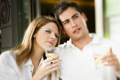 Happy couple having a drink Royalty Free Stock Photos