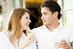 Happy couple having a drink Stock Photo