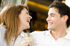 Happy couple having a drink Stock Photography