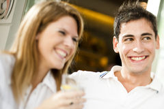 Happy couple having a drink Royalty Free Stock Photo