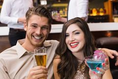 Happy couple having a drink together Royalty Free Stock Photo