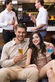 Happy couple having a drink together. At the bar Royalty Free Stock Photos