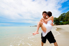 Happy couple having fun at the beach Royalty Free Stock Photography