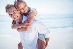 Happy couple having fun on the beach Royalty Free Stock Image