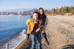Happy couple having fun at the beach on a sunny Royalty Free Stock Photos