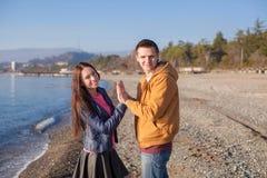 Happy couple having fun at the beach on a sunny Stock Photography