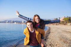 Happy couple having fun at the beach on a sunny Stock Image