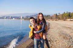 Happy couple having fun at the beach on a sunny Royalty Free Stock Photo