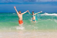 Happy couple having fun on the beach of a tropical island. Summe Royalty Free Stock Photo