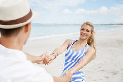Happy couple having fun on the beach Stock Photos