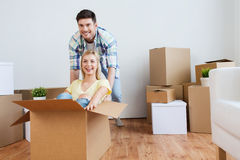 Happy couple having fun with boxes at new home Stock Photography