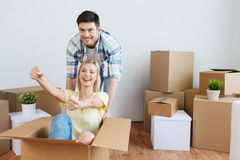Happy couple having fun with boxes at new home Royalty Free Stock Photos