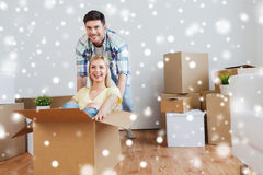 Happy couple having fun with boxes at new home Stock Photos