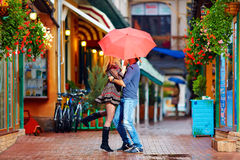 Happy couple having fun on colorful street Royalty Free Stock Images