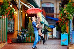 Happy couple having fun on colorful street Stock Images