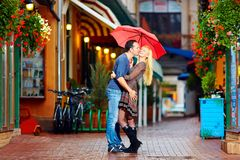 Happy couple having fun on colorful street Royalty Free Stock Photography