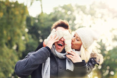 Happy couple having fun on a date in the park Royalty Free Stock Photo