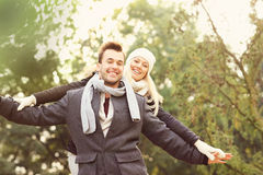 Happy couple having fun on a date in the park Royalty Free Stock Photography