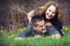 Happy couple having fun on grass Royalty Free Stock Photos