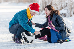 Happy couple having fun ice skating on rink outdoors. royalty free stock images