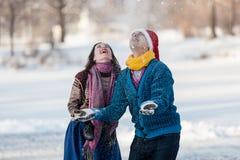 Happy couple having fun ice skating on rink outdoors. Stock Photo