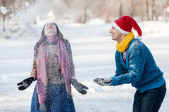 Happy couple having fun ice skating on rink outdoors. Stock Image