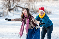 Happy couple having fun ice skating on rink outdoors. Royalty Free Stock Image