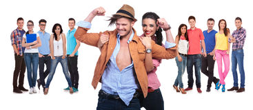 Happy Couple Having Fun In Front Of Their Large Group Of Friends Royalty Free Stock Photos