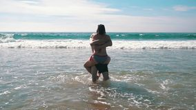Happy Couple Having Fun on Ocean Waves stock video footage