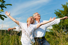Happy couple having fun outdoors in summer stock photo