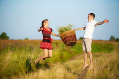 Happy couple having fun outdoors in summer meadow Stock Photo