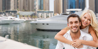 Happy couple having fun over dubai city harbour Royalty Free Stock Images