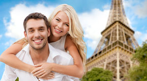 Happy couple having fun over eiffel tower royalty free stock images