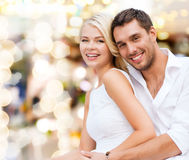 Happy couple having fun over lights background Royalty Free Stock Images