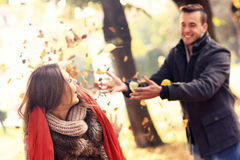 Happy couple having fun in the park in autumn Royalty Free Stock Photos